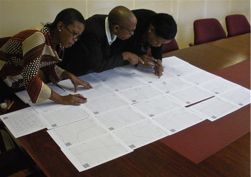 Members of a District Health Management Team in Botswana use Field Papers to make contributions to OpenStreetMap.(Source: Owen and Becky Carnes)