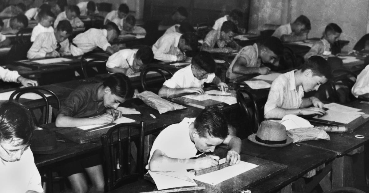 Children studying in an old classroom