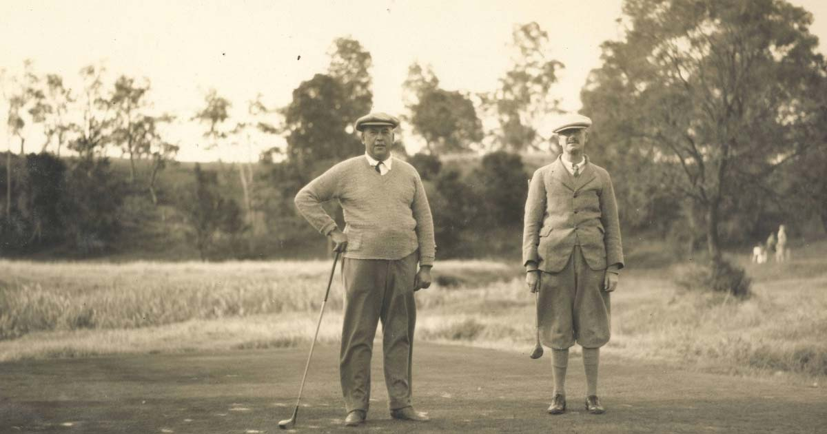 Two elderly gentlemen playing golf at a country club