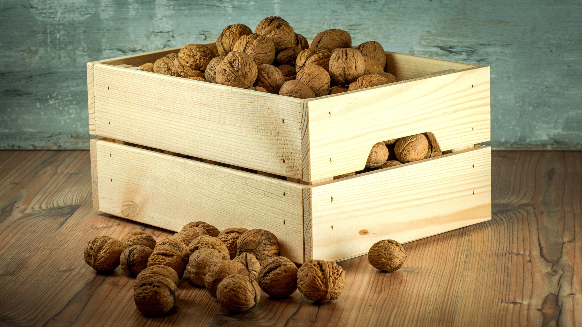 A wooden box full of nuts