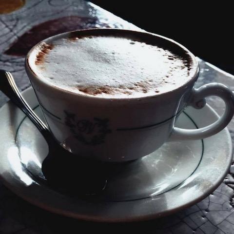 Recalibrating with a delicious cappuccino in Rimini, Italy.