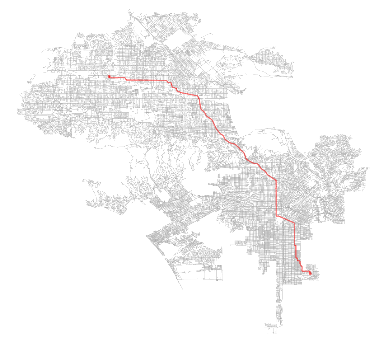 Figure 1. OSMnx retrieves the street network for Los Angeles, California and plots a shortest-path route along it.